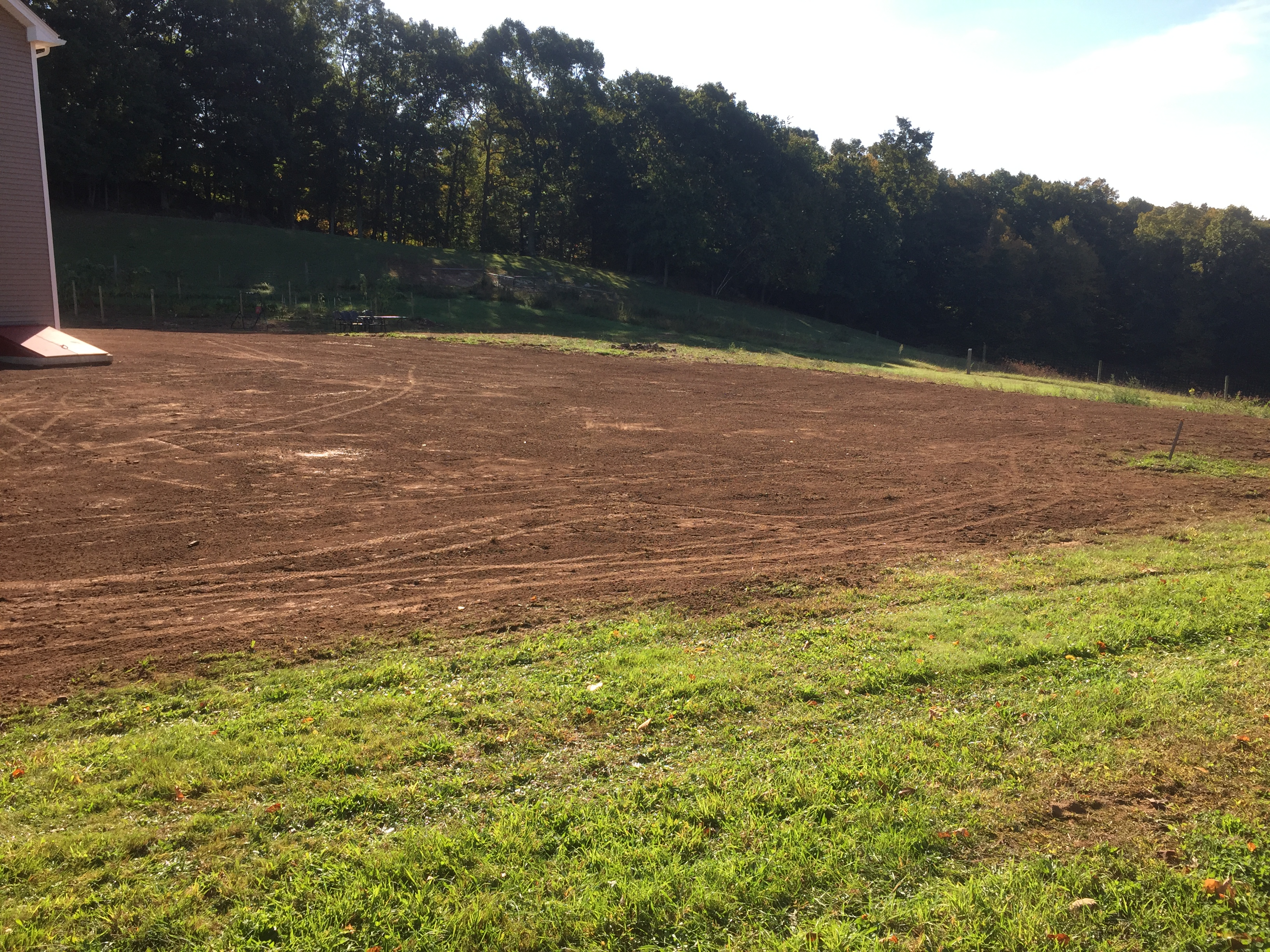Topsoil grading quality landscaping for Quality topsoil